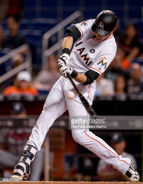 Christian Yelich of the Miami Marlins at bat during the first inning of the game against the Atlanta Braves at Marlins Park on September 30 2017 in...