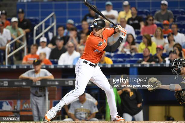 Christian Yelich of the Miami Marlins bats during a MLB game against the Pittsburgh Pirates at Marlins Park on April 30 2017 in Miami Florida