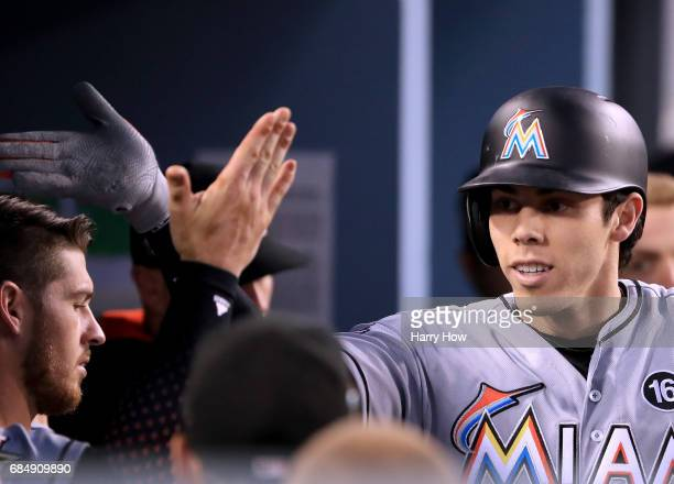 Christian Yelich of the Miami Marlins celebrates his solo homerun to trail 42 to the Los Angeles Dodgers during the third inning at Dodger Stadium on...
