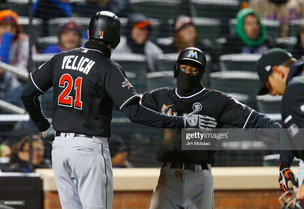 Christian Yelich #21 of the Miami Marlins celebrates his third inning two run home run against the New York Mets with teammate Dee Gordon #9 at Citi Field on April 7, 2017 in the Flushing neighborhood of the Queens borough of New York City.