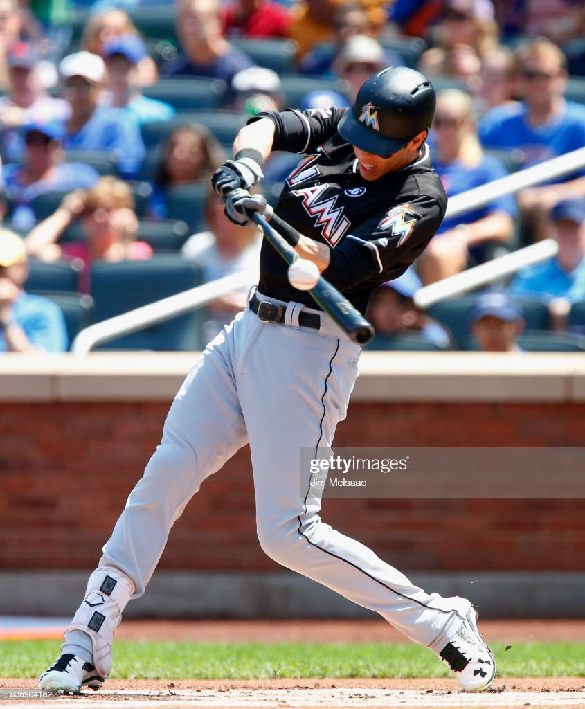 Christian Yelich #21 of the Miami Marlins connects on a first inning RBI single against the New York Mets at Citi Field on August 20, 2017 in the Flushing neighborhood of the Queens borough of New York City.
