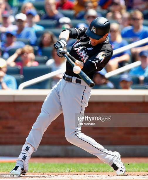 Christian Yelich of the Miami Marlins connects on a first inning RBI single against the New York Mets at Citi Field on August 20 2017 in the Flushing...