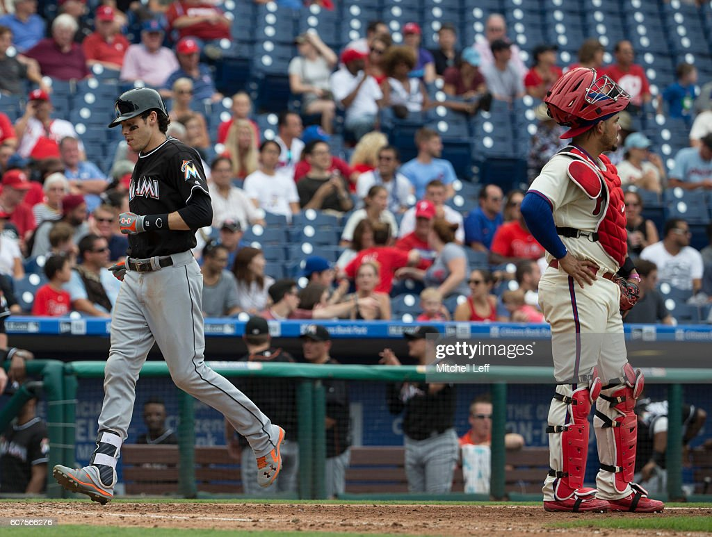 Christian Yelich #21 of the Miami Marlins crosses home plate in front of Jorge Alfaro #38 of the Philadelphia Phillies after his two run home run in the top of the eighth inning at Citizens Bank Park on September 18, 2016 in Philadelphia, Pennsylvania. The Marlins defeated the Phillies 5-4.
