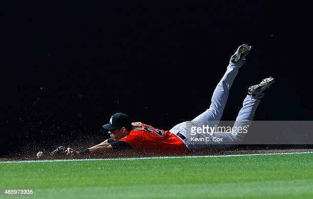 Christian Yelich of the Miami Marlins drops a double hit by Jordan Schafer of the Atlanta Braves in the ninth inning at Turner Field on April 21 2014...