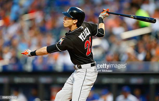 Christian Yelich of the Miami Marlins follows through on a first inning two run home run against the New York Mets at Citi Field on August 30 2016 in...