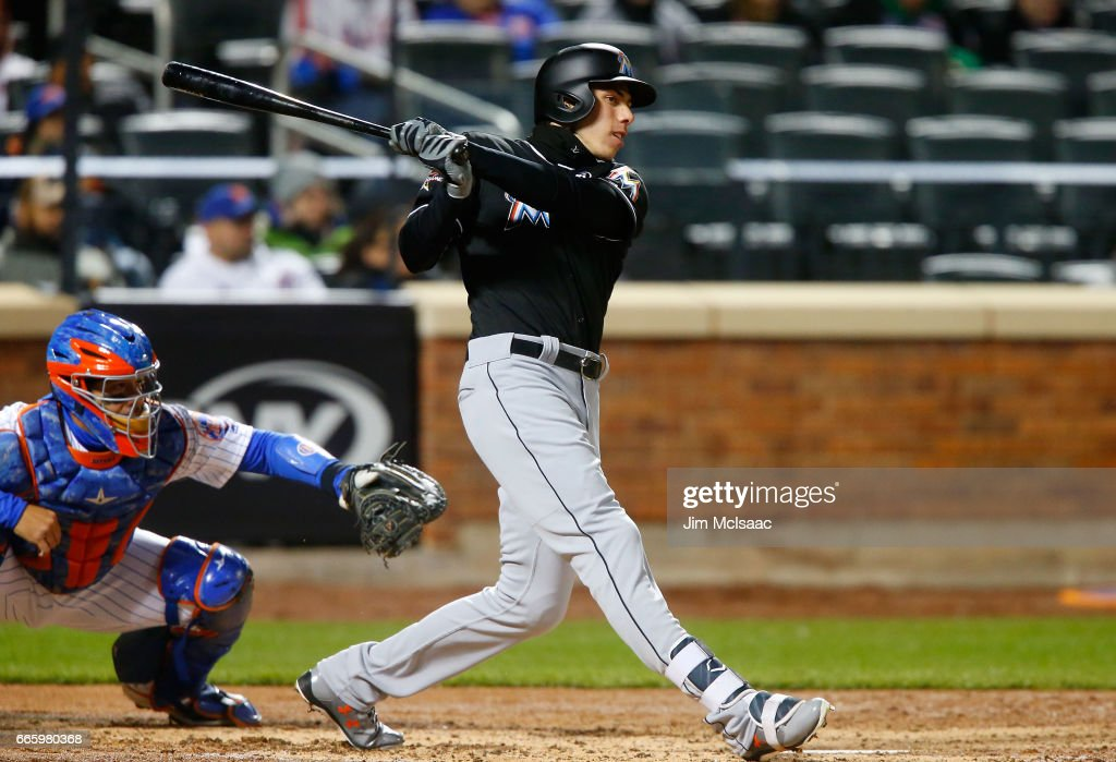 Christian Yelich #21 of the Miami Marlins follows through on his third inning two run home run against the New York Mets at Citi Field on April 7, 2017 in the Flushing neighborhood of the Queens borough of New York City.