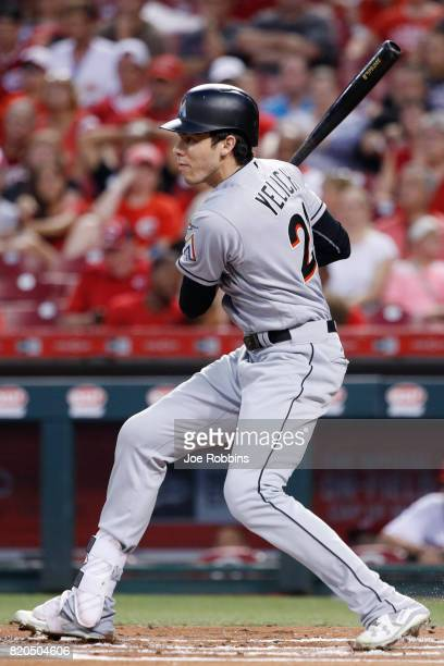 Christian Yelich of the Miami Marlins grounds out to second base to drive in a run in the first inning of a game against the Cincinnati Reds at Great...