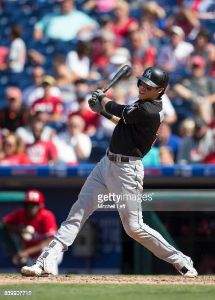 Christian Yelich of the Miami Marlins hits a solo home run in the top of the sixth inning against the Philadelphia Phillies at Citizens Bank Park on...