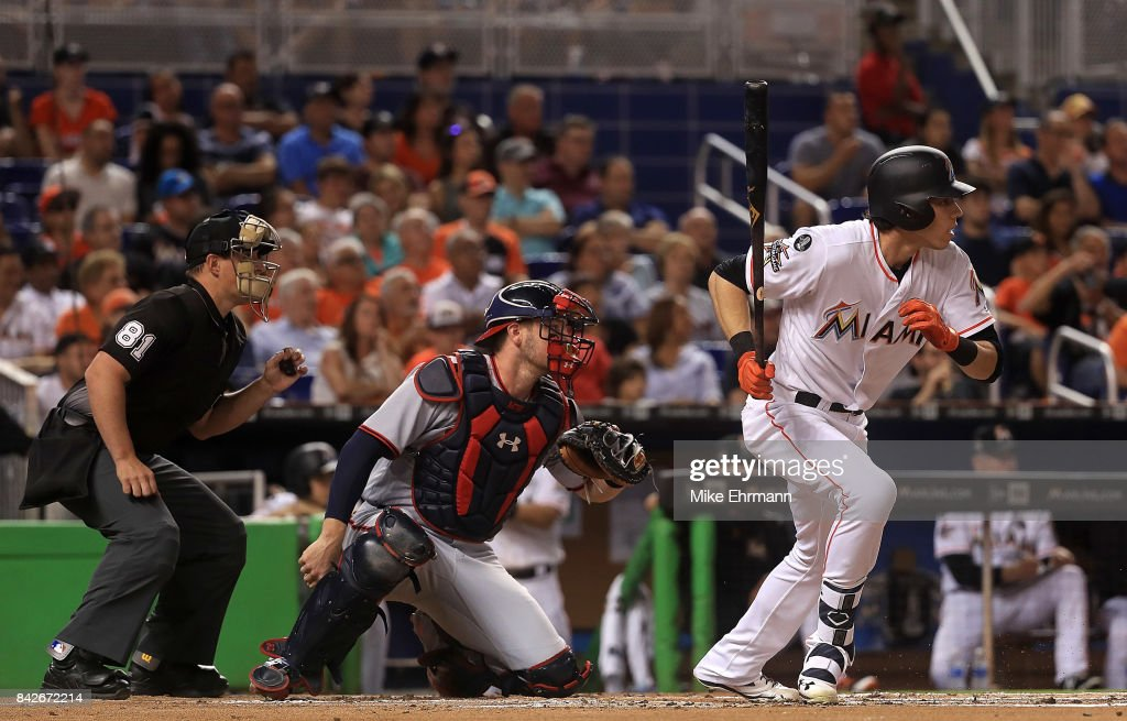Christian Yelich #21 of the Miami Marlins hits an RBI on a fielders choice during a game against the Washington Nationals at Marlins Park on September 4, 2017 in Miami, Florida.