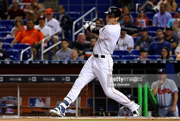Christian Yelich of the Miami Marlins hits during a game against the Atlanta Braves at Marlins Park on April 15 2016 in Miami Florida All players are...