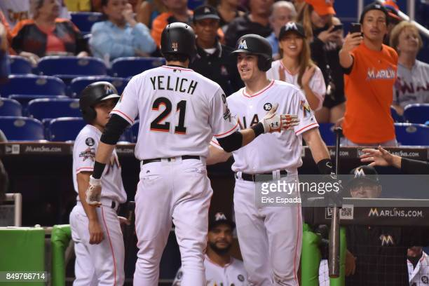 Christian Yelich of the Miami Marlins is congratulated by JT Realmuto after hitting a home run in the fourth inning against the New York Mets at...