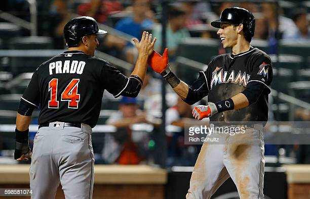 Christian Yelich of the Miami Marlins is congratulated by Martin Prado after hitting a threerun home run in the seventh inning against the New York...