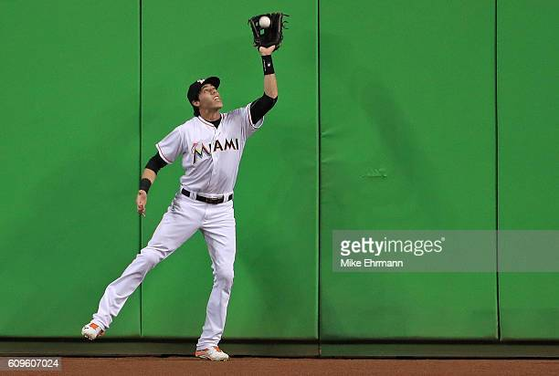 Christian Yelich of the Miami Marlins makes a catch at the wall during a game against the Washington Nationals at Marlins Park on September 21 2016...