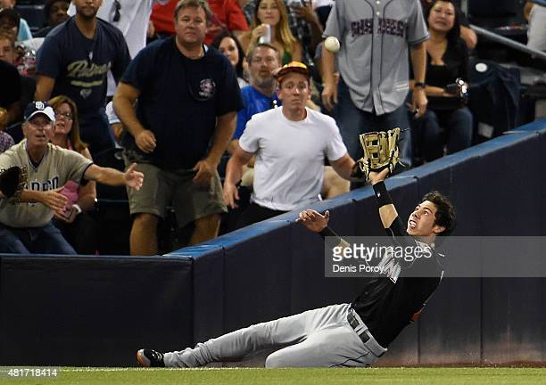 Christian Yelich of the Miami Marlins makes a sliding catch on a foul ball hit by Abraham Almonte of the San Diego Padres during the third inning of...
