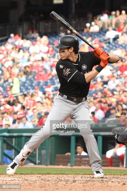 Christian Yelich of the Miami Marlins prepares for a pitch during a baseball game against the Washington Nationals at Nationals Park on August 30...