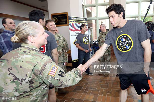 Christian Yelich of the Miami Marlins shakes hands with a member of the military during the visit to the Womack Army Medical Center at Fort Bragg on...