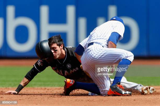 Christian Yelich of the Miami Marlins steals second base in the first inning ahead of the tag from Gavin Cecchini of the New York Mets at Citi Field...