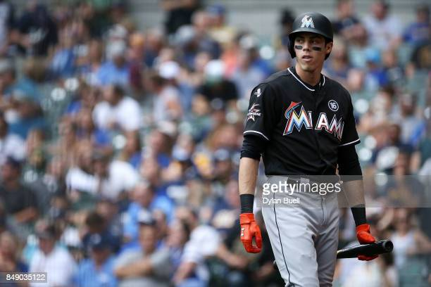 Christian Yelich of the Miami Marlins walks back to the dugout after striking out in the fourth inning against the Milwaukee Brewers at Miller Park...