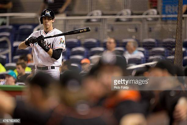 Christian Yelich of the Miami Marlins warms up in the on deck circle during the first inning of the game against the Colorado Rockies at Marlins Park...