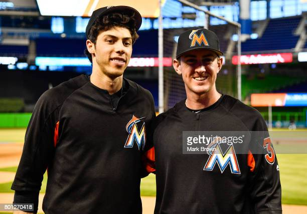 Christian Yelich of the Miami Marlins with draft pick Brian Miller before the game between the Miami Marlins and the Chicago Cubs at Marlins Park on...