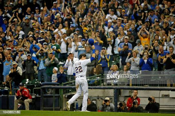 Christian Yelich of the Milwaukee Brewers acknowledges the crowd as he receives a standing ovation as he is taken out of the game against the Detroit...