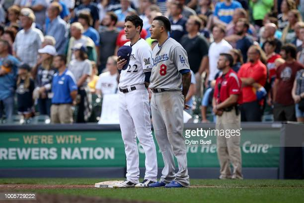 Christian Yelich of the Milwaukee Brewers and Manny Machado of the Los Angeles Dodgers meet in the seventh inning at Miller Park on July 22 2018 in...