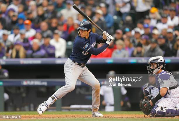 Christian Yelich of the Milwaukee Brewers at bat in the third inning of Game Three of the National League Division Series against the Colorado...