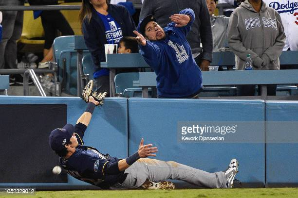 Christian Yelich of the Milwaukee Brewers can't make the catch against the Los Angeles Dodgers during the eighth inning in Game Four of the National...