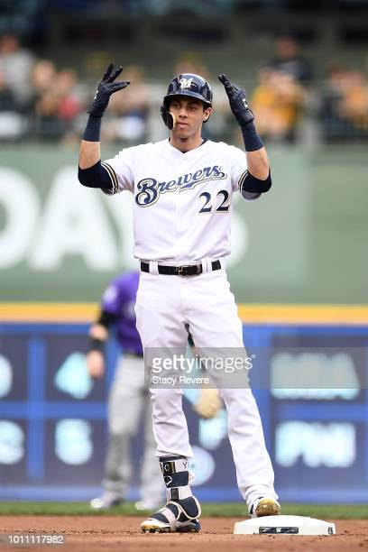 Christian Yelich of the Milwaukee Brewers celebrates a double against the Colorado Rockies during the first inning of a game at Miller Park on August...