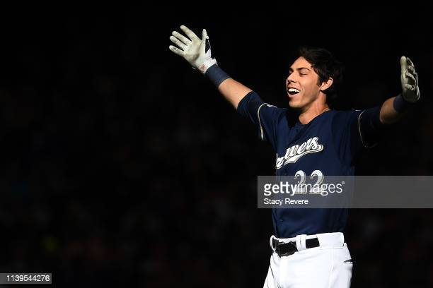 Christian Yelich of the Milwaukee Brewers celebrates after driving in the game winning runs against the St Louis Cardinals at Miller Park on March 31...