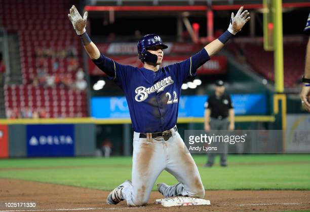 Christian Yelich of the Milwaukee Brewers celebrates after hitting a tripple in the 7th inning against the Cincinnati Reds at Great American Ball...