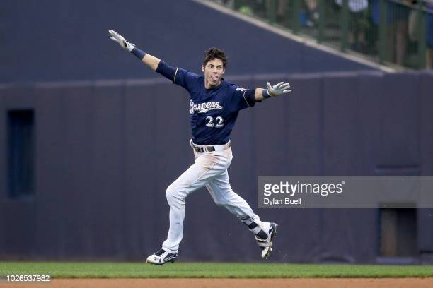 Christian Yelich of the Milwaukee Brewers celebrates after hitting a fielder's choice to beat the Chicago Cubs 43 at Miller Park on September 3 2018...
