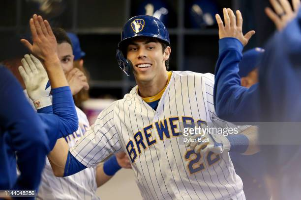 Christian Yelich of the Milwaukee Brewers celebrates with teammates after hitting a home run in the sixth inning against the Los Angeles Dodgers at...
