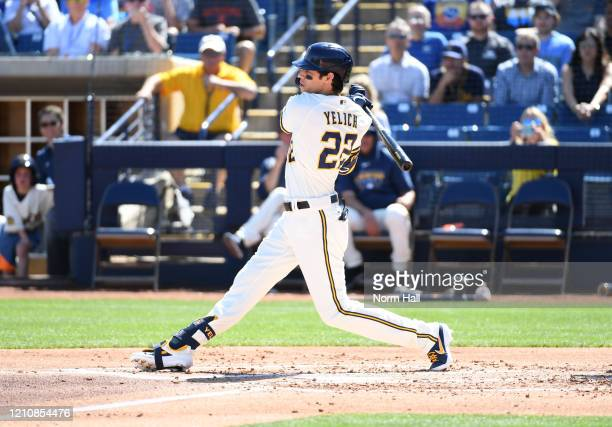 Christian Yelich of the Milwaukee Brewers follows through on a swing during the first inning of a spring training game against the San Francisco...