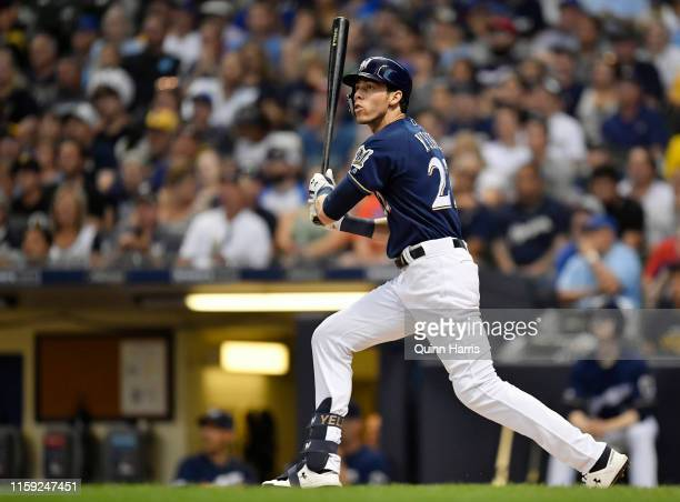 Christian Yelich of the Milwaukee Brewers hits a double in the third inning against the Pittsburgh Pirates for his 1000th career hit at Miller Park...