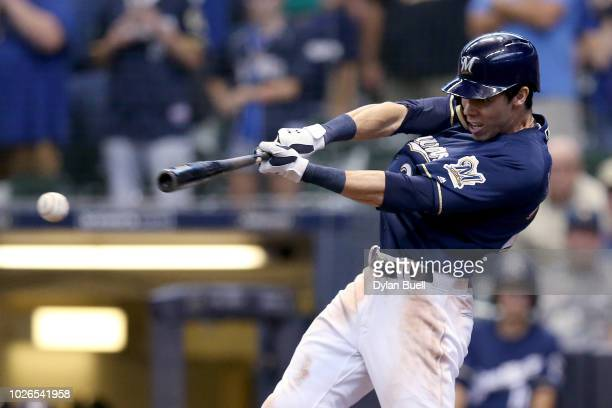 Christian Yelich of the Milwaukee Brewers hits a fielder's choice to beat the Chicago Cubs 43 at Miller Park on September 3 2018 in Milwaukee...