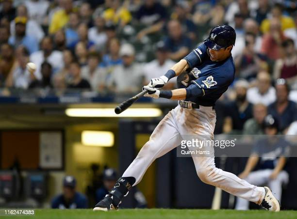 Christian Yelich of the Milwaukee Brewers hits a grand slam in the seventh inning against the Atlanta Braves at Miller Park on July 16 2019 in...