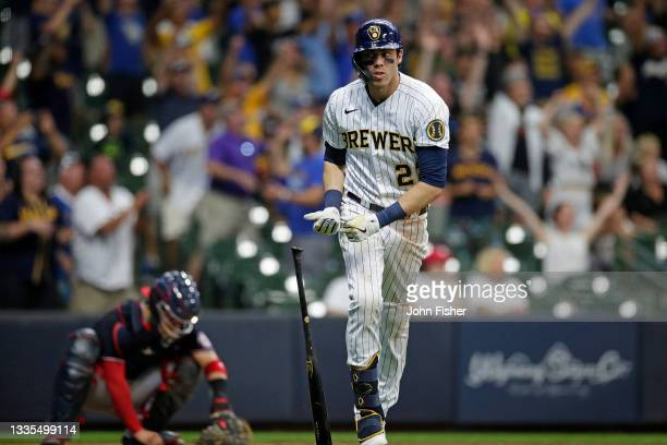 Christian Yelich of the Milwaukee Brewers hits a grand slam in the eighth inning against the Washington Nationals at American Family Field on August...