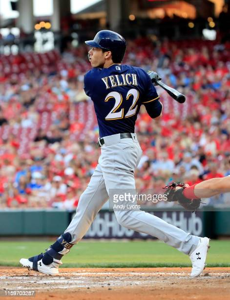 Christian Yelich of the Milwaukee Brewers hits a home run in the fourth inning against the Cincinnati Reds at Great American Ball Park on July 02,...