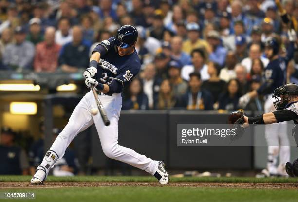 Christian Yelich of the Milwaukee Brewers hits a homerun to score Lorenzo Cain in the third inning of Game One of the National League Division Series...