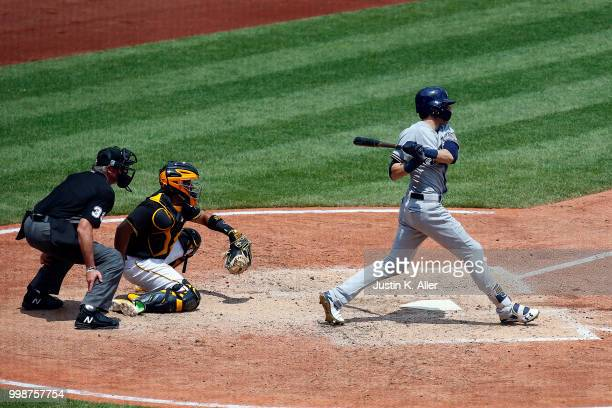 Christian Yelich of the Milwaukee Brewers hits a RBI single in the fifth inning during game one of a doubleheader against the Pittsburgh Pirates at...