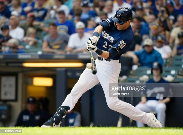 Christian Yelich of the Milwaukee Brewers hits a single in the fifth inning against the Seattle Mariners at Miller Park on June 27 2019 in Milwaukee...