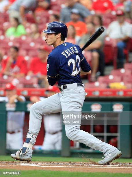 Christian Yelich of the Milwaukee Brewers hits a single in the first inning against the Cincinnati Reds at Great American Ball Park on August 29 2018...