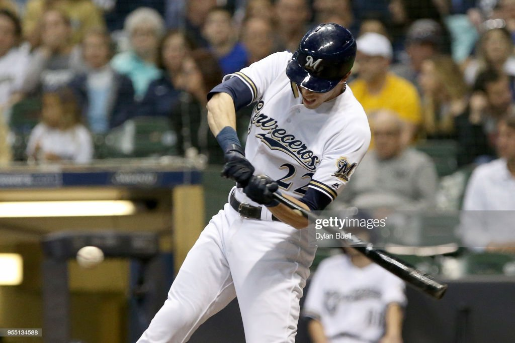 Christian Yelich #22 of the Milwaukee Brewers hits a single in the seventh inning against the Pittsburgh Pirates at Miller Park on May 5, 2018 in Milwaukee, Wisconsin.