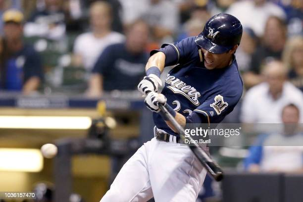 Christian Yelich of the Milwaukee Brewers hits a double in the first inning against the Cincinnati Reds at Miller Park on September 19 2018 in...