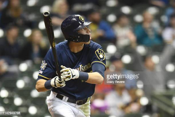 Christian Yelich of the Milwaukee Brewers hits a solo home run during the eighth inning of a game against the St Louis Cardinals at Miller Park on...