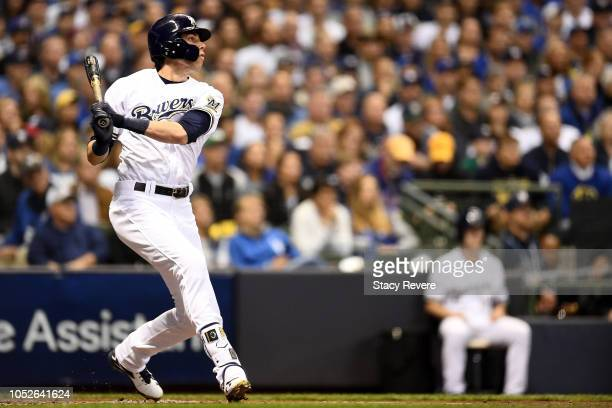 Christian Yelich of the Milwaukee Brewers hits a solo home run against Walker Buehler of the Los Angeles Dodgers during the first inning in Game...