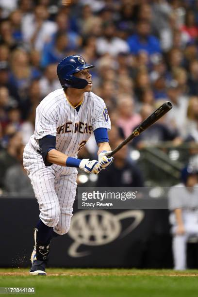 Christian Yelich of the Milwaukee Brewers hits a three run home run against the Chicago Cubs during the third inning at Miller Park on September 06...