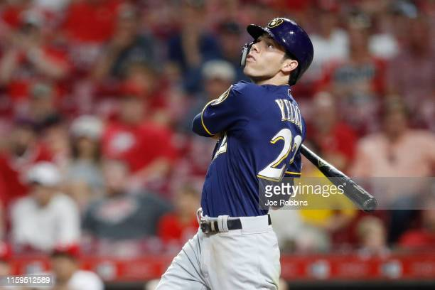 Christian Yelich of the Milwaukee Brewers hits a two-run home run to extend his team's lead in the ninth inning against the Cincinnati Reds at Great...