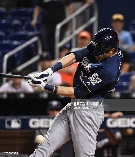 Christian Yelich of the Milwaukee Brewers hits the ball off his knee in the first inning against the Miami Marlins at Marlins Park on September 10...